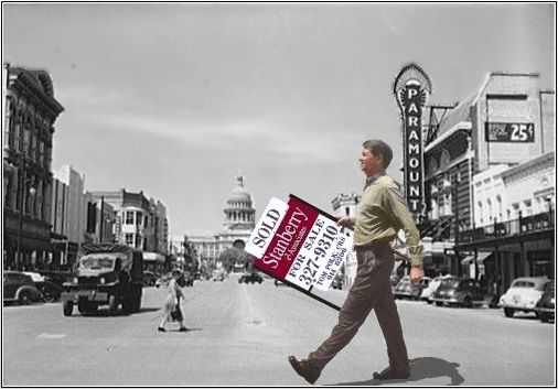 Tom Polk walking with SOLD sign